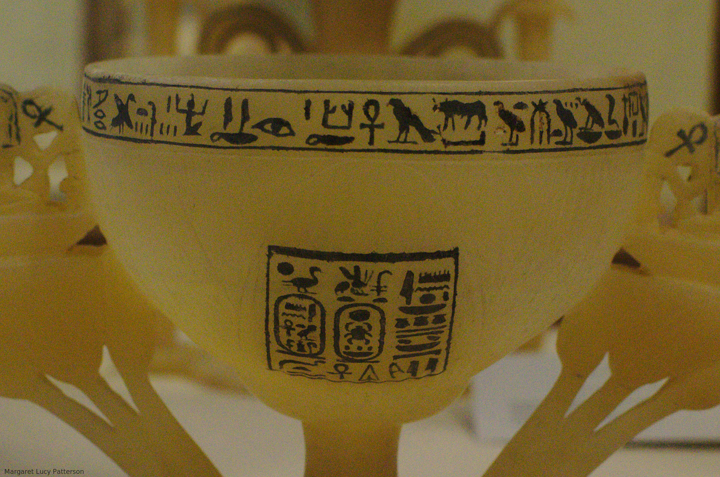 An alabaster vase decorated with hieroglyphs, including the Son of Re and Dual King names of Tutankhamun.
