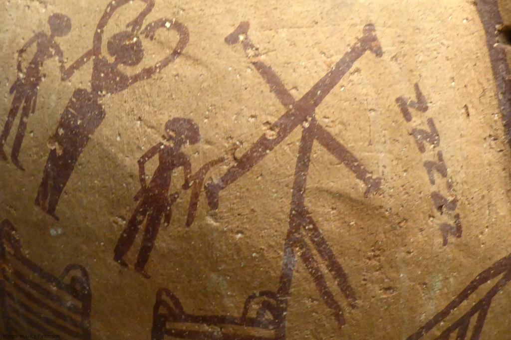 Predynastic pot painted with red decoration including an early version of the Neith symbol of crossed arrows on a pole.
